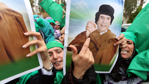 Libyan women hold pictures of Libyan leader Moamer Kadhafi in Tripoli on March 19, 2011 during a protest against the UN Security Council Resolution 1973 which authorise all necessary measures to establish a no-fly zone which resulted in regime-change. by Pan-African News Wire File Photos