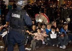 Los Angeles cops attack the Occupy Movement arresting dozens. The federal government has coordinated the busting up of anti-capitalist demonstrations across the country. by Pan-African News Wire File Photos