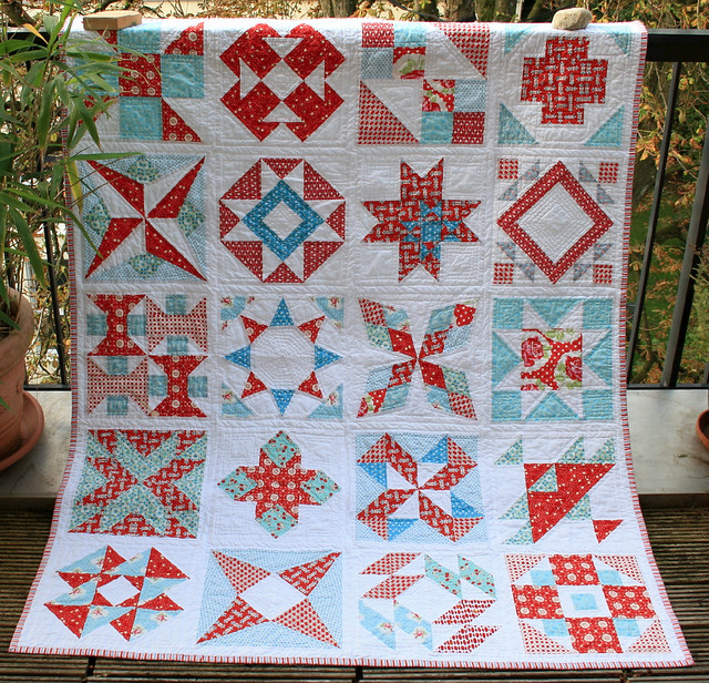 summer sampler quilt hanging