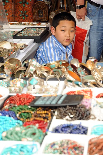 Young Tibetan businessman wearing a striped blue shirt, malas, beads, jewelry, Happy Birthday to His Holiness the Dalai Lama Parade, Americans, Tibetans at Kalachakra, Washington D.C., USA by Wonderlane