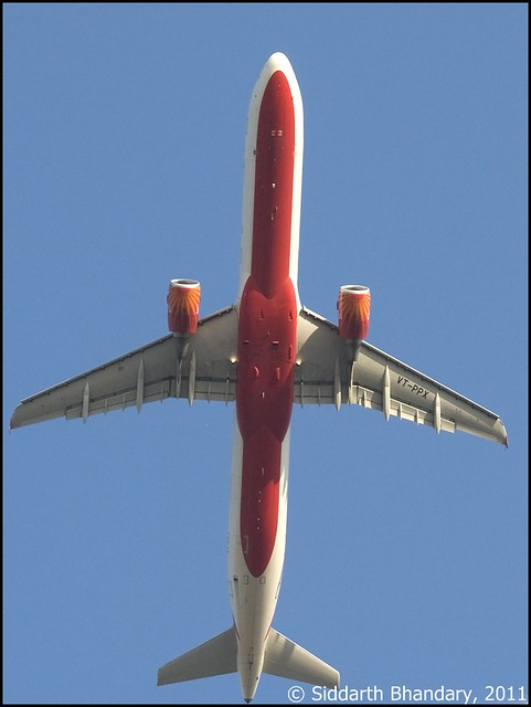 Air India Airbus A321 (VT-PPX) flies over head as it climbs out of RWY 27