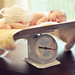 newborn on a scale