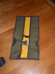 Green tool roll with yellow lining