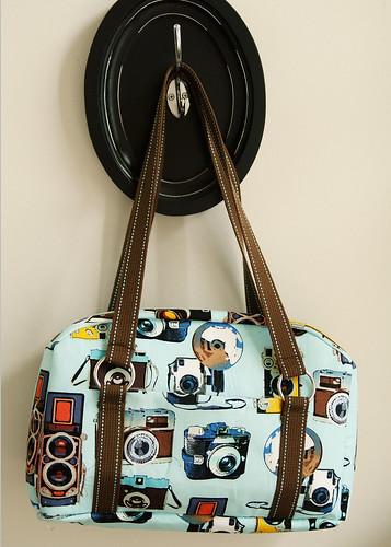 IJ suitcase-style purse