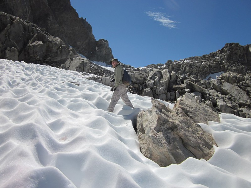 Traversing a patch of softening suncup-snow on the final climb to Thunderbolt Pass