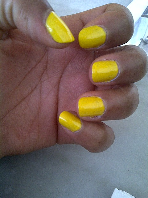 Getting used to this yellow nail polish. Colour doesn't seem right