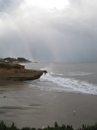 double rainbow over the pacific ocean