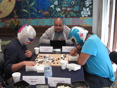 Mexican wrestlers playing Go