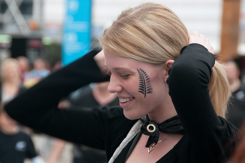 All Blacks NZ Rugby Fan smiles after getting Silver Fern Leaf face paint