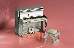 Miniature silver upright piano (open)