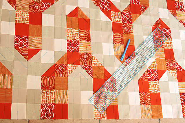 Marking out the quilting pattern to echo the shape of the chevrons
