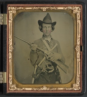 [Unidentified cavalry soldier in Confederate uniform with slant breech sharps carbine, two knives, and two revolvers] (LOC)