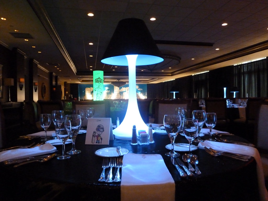 White Spandex Centerpiece With Black Lamp Shade For A Bar