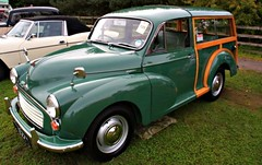 austin fx4(0.0), compact car(0.0), automobile(1.0), automotive exterior(1.0), vehicle(1.0), mid-size car(1.0), morris minor(1.0), antique car(1.0), sedan(1.0), classic car(1.0), vintage car(1.0), land vehicle(1.0),