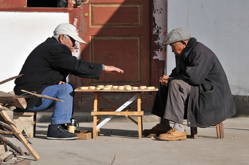 Baisha China - old men playing Chinese chess