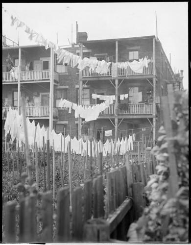 Laundry on lines behind triple deckers