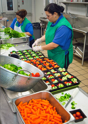 Magaly Valentin (left), and Rosalba Gomez (right) Arlington Food Services prepare fresh salads and vegetable cups for the National School Lunch Program in the kitchen at Washington-Lee High School in Arlington, Virginia. USDA Photo: Bob Nichols.