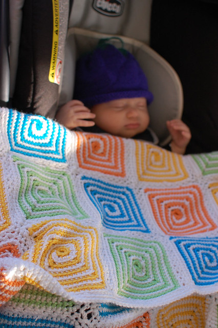 Indira and the blanket I crocheted for her