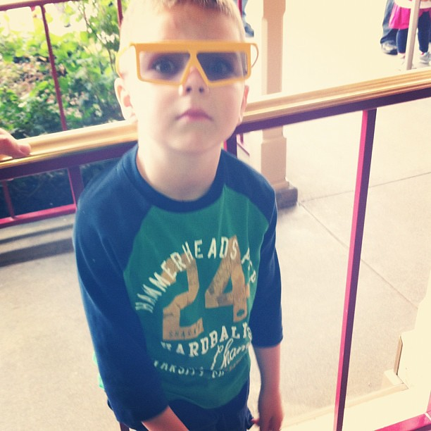 Project 365 322/365: Angry Kid is too cool with his 3D glasses for the Toy Story Ride. #disneyholidays