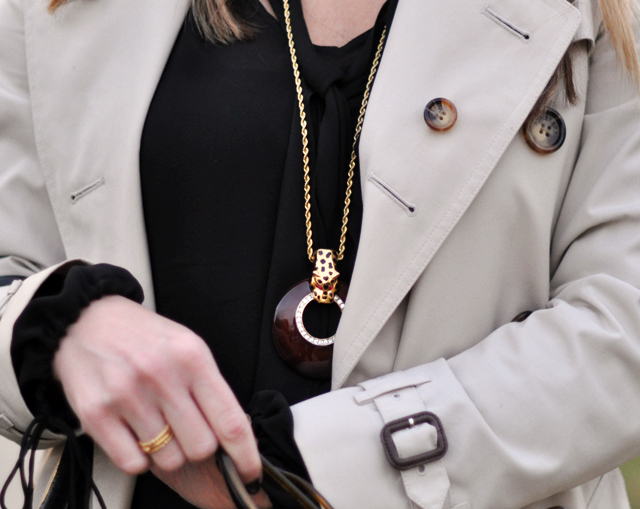 animal pendant and trench coat