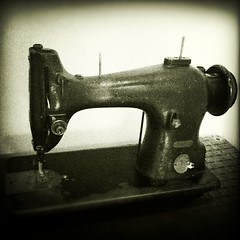 wheel(0.0), sewing machine(1.0), art(1.0), iron(1.0),