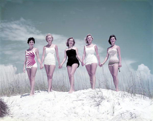 Unidentified young women modeling on a sand dune at the beach: Panama City, Florida