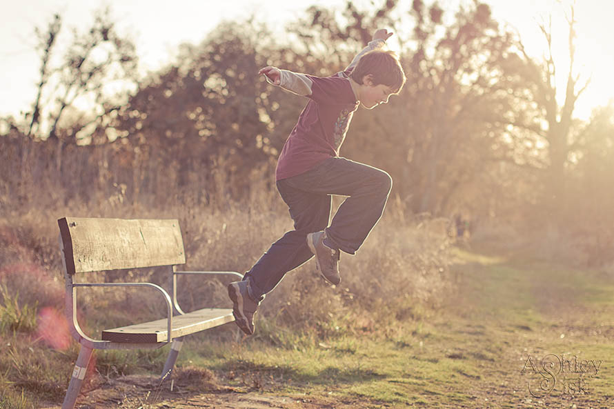 Kid Jumping in the Sunlight Photo
