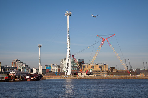 North and intermediate towers of Thames cable car with crane and aeoroplane - 27 March 2012