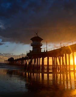 huntington beach pier at sunset with flare and bokeh