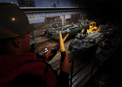 SOUTH CHINA SEA (Nov. 1, 2011) Seaman Henry Stumpf directs an amphibious assault vehicle assigned to the 31st Marine Expeditionary Unit in the well deck of USS Germantown (LSD 42).  (U.S. Navy photo by Mass Communication Specialist 2nd Class Casey H. Kyhl)
