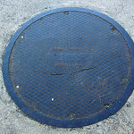 Neenah Foundry Co. cracked manhole cover