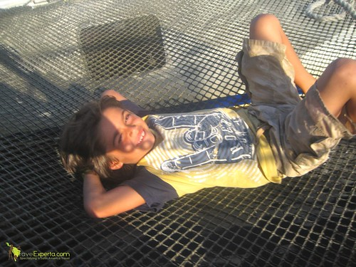 Chilling on a Net on Catamaran Tour - Kid Friendly Utila Honduras