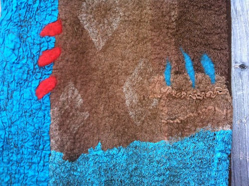 Detail of chocolate and turquoise wrap