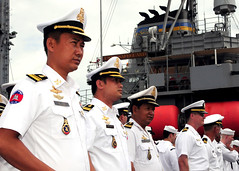SIHANOUKVILLE, Cambodia (Oct. 20, 2011) Royal Cambodian Navy Officers stand alongside U.S. Navy counterparts in front of USNS Safeguard (T-ARS 50) during the opening ceremony for Cooperation Afloat Readiness and Training (CARAT) Cambodia 2011. (U.S. Navy photo by Mass Communications Specialist 1st Class Robert Clowney)