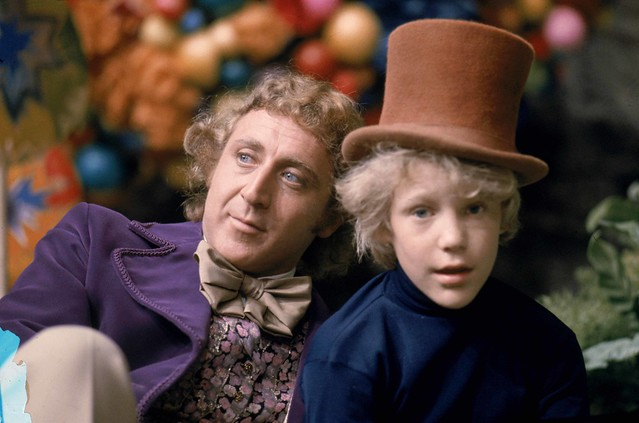 25-12-11@ 14.20 Scannán Willy Wonka and the Chocolate Factory-Gene Wilder as Willy Wonka and Peter Ostrum as Charlie Bucket, wearing Wonka's top hat