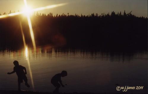 sunset lake kids silhouettes calm