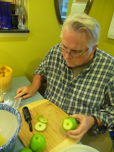 Dad chops apples