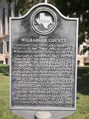 Photo of Josiah P. Wilbarger and Mathias Wilbarger black plaque