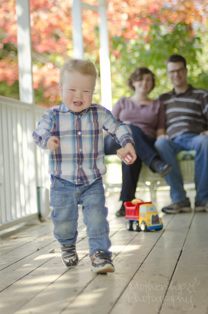 Porch Portraits with energetic Everitt and his parents