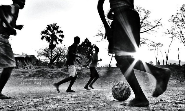 Soccer game in Africa by flickr user stefanopesarelli