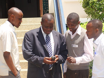 mbale_town_clerk_joseph_kimbowa_learning_the_use_of_handheld_gps_in_stdm_web