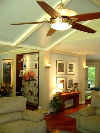 Family Room Gallery Walls with Ceiling Fan, Brazilian Cherry Wood Flooring