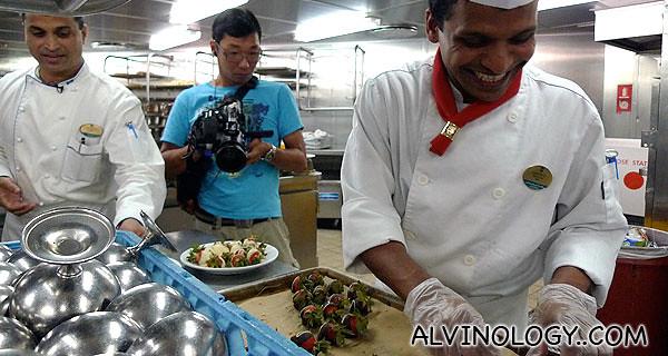 The jovial dessert chef making chocolate-coated strawberries