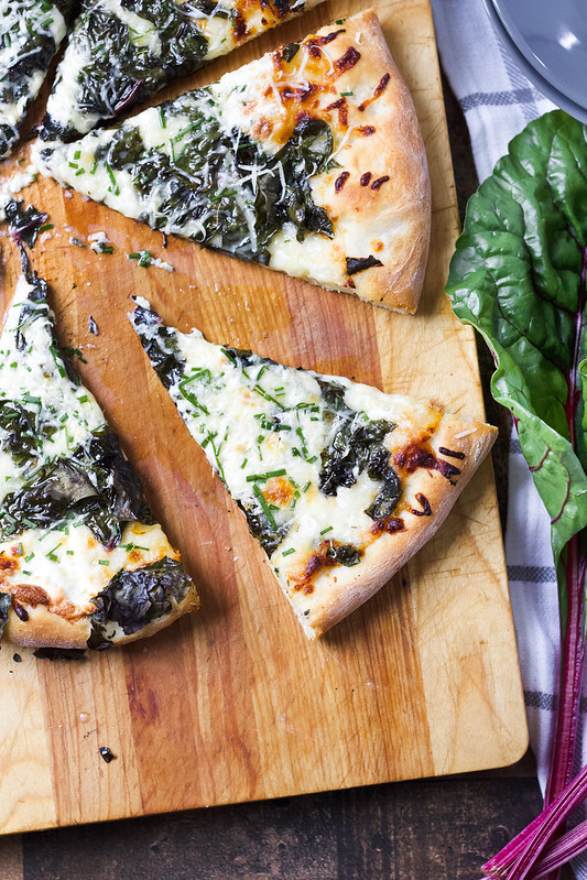 Swiss chard pizza with roasted garlic cream
